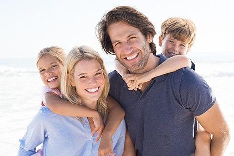 Image of a family with beautiful smiles - meet Dr. Teng, an orthodontist in Bellevue